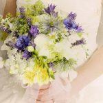 Country style handtied of white roses, nigella, cornflowers,