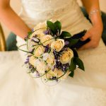 Cream rose and blue agapanthus handtied