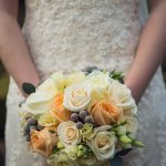 Bridal handtied of peach and creams with silver berries