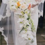 Shower bouquet of orchids and roses
