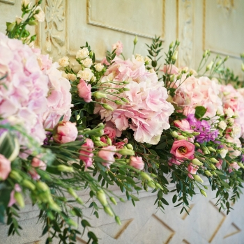 Flowers over a fireplace
